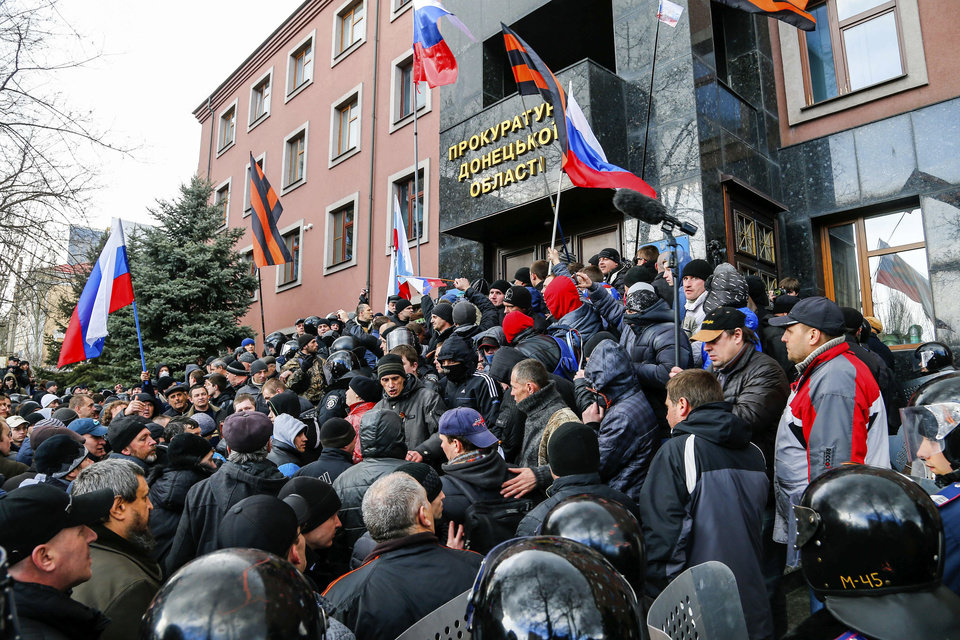 Photo - Pro-Russia demonstrators storm the prosecutor-general's office during a rally in Donetsk, Ukraine, Sunday, March 16, 2014. Pro-Russia demonstrators in the eastern city of Donetsk called Sunday for a referendum similar to the one in Crimea as some of them stormed the prosecutor-general's office. (AP Photo/Andrey Basevich)