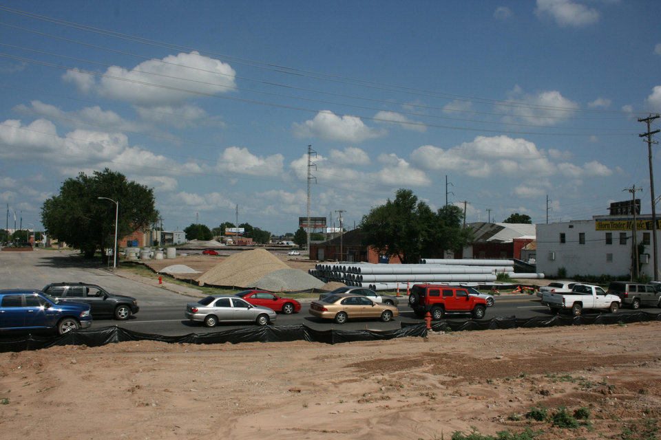 Photo - Traffic backs up on Western Avenue where the future boulevard is planned. Horn Trader Music is seen to the right.  Provided