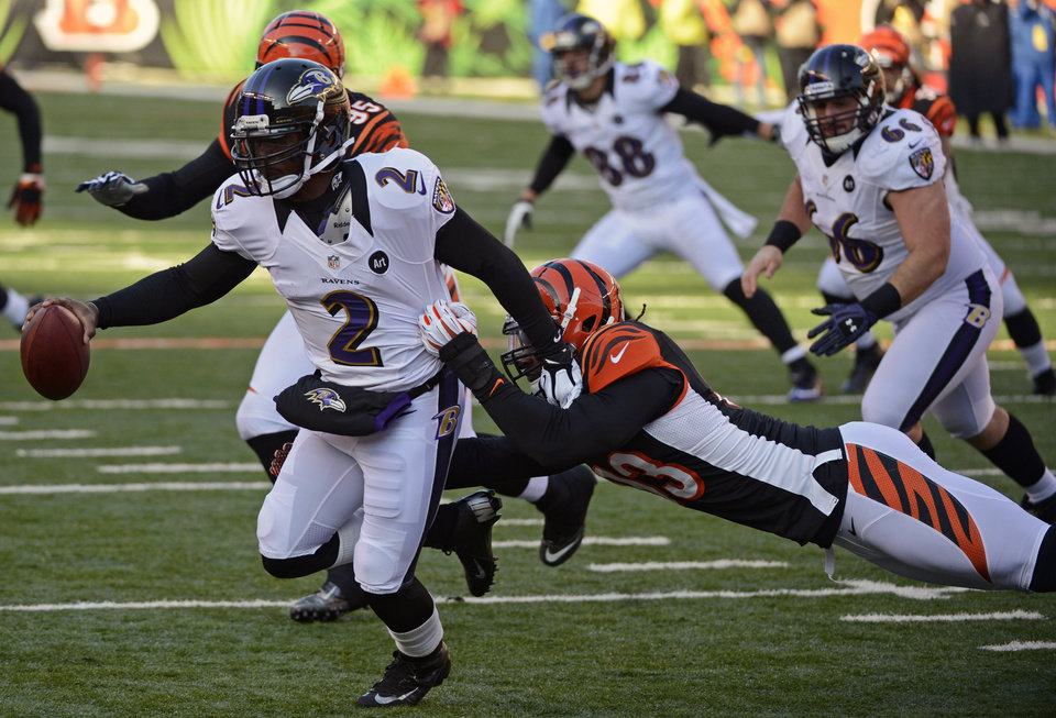 Photo - Baltimore Ravens quarterback Tyrod Taylor (2) is sacked by Cincinnati Bengals defensive end Michael Johnson (93) in the first half of an NFL football game on Sunday, Dec. 30, 2012, in Cincinnati. (AP Photo/Michael Keating)