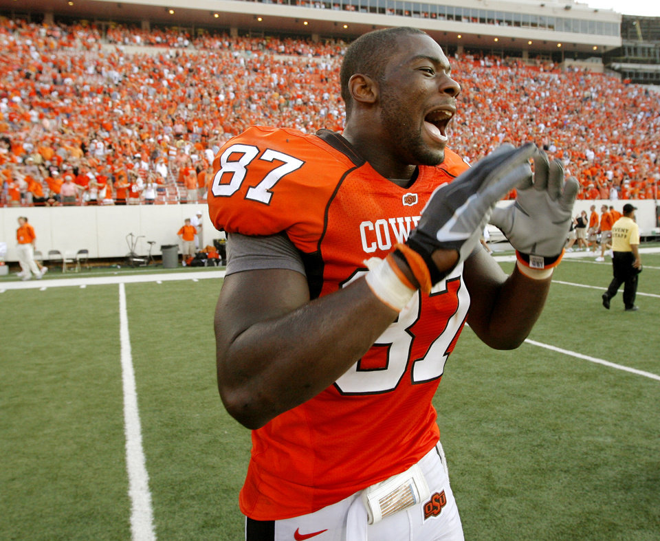 Photo - OSU's Brandon Pettigrew (87) yells at teammates after the college football game between the Oklahoma State University Cowboys (OSU) and the Texas Tech University Red Raiders (TTU) at Boone Pickens Stadium in Stilwater, Okla., on Saturday, Sept. 22, 2007. OSU won, 49-45. By NATE BILLINGS, The Oklahoman