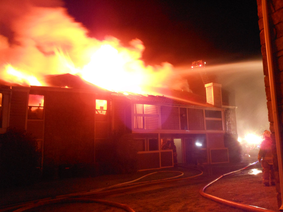 Photo - A 4 a.m. apartment fire July 15 at Raindance Apartments near NW 122 and N Pennsylvania Avenue in Oklahoma City destroyed 16 units, fire officials said.   Silas Allen