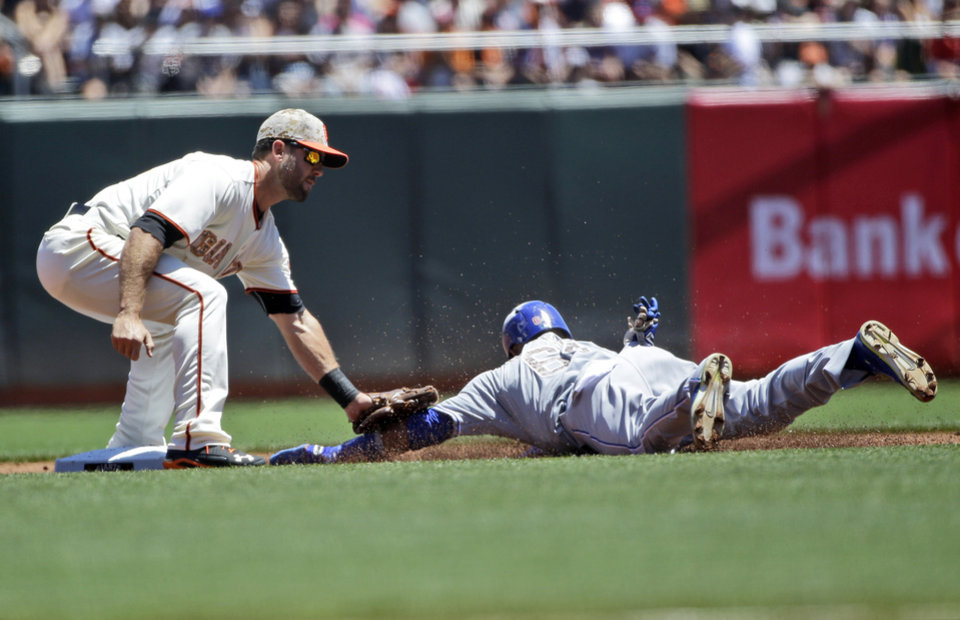 Photo - Chicago Cubs' Emilio Bonifacio, right, is tagged out trying to steal second base by San Francisco Giants second baseman Brandon Hicks during the first inning of a baseball game on Monday, May 26, 2014, in San Francisco. (AP Photo/Marcio Jose Sanchez)