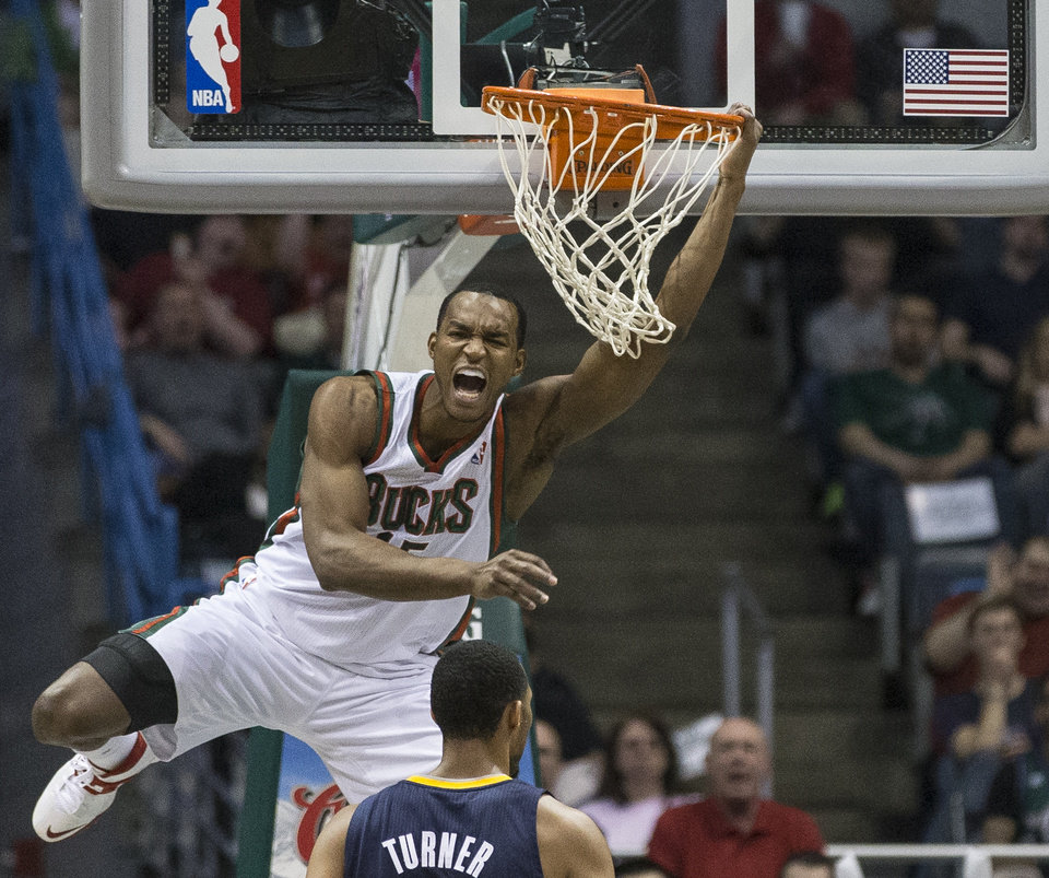 Photo - Milwaukee Bucks' Chris Wright reacts to his alley-oop dunk against the Indiana Pacers during the second half of an NBA basketball game on Wednesday, April 9, 2014, in Milwaukee. (AP Photo/Tom Lynn)