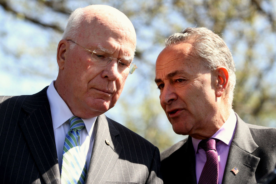 Photo - Sen. Patrick Leahy, D-Vt., left, and Sen. Charles Schumer, D-N.Y., talk on Capitol Hill in Washington, Tuesday, March 27, 2012, during a news conference by Senate Democrats on health care on the second day of the Supreme Court hearing on President Obama's health care legislation. (AP Photo/Jacquelyn Martin) ORG XMIT: DCJM103