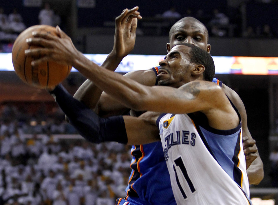 Photo - Memphis Grizzlies guard Mike Conley (11) drives against Oklahoma City Thunder center Nazr Mohammed during the first half of Game 4 of a second-round NBA basketball playoff series on Monday, May 9, 2011, in Memphis, Tenn. (AP Photo/Wade Payne)