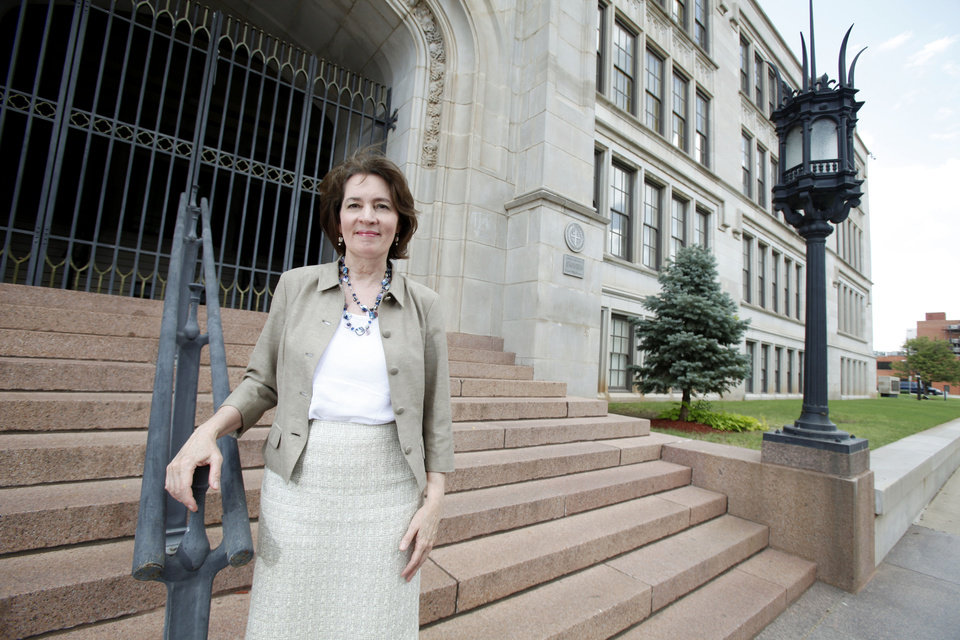 Photo - Oklahoma City University Dean of Law School Valerie Couch stands in front of Central High School.  Steve Gooch - The Oklahoman