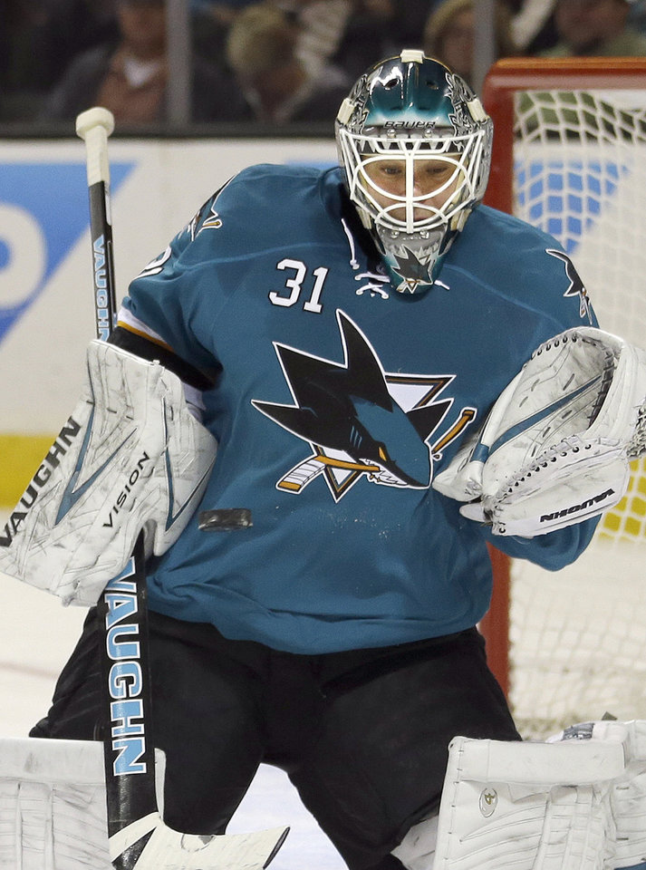 Photo - San Jose Sharks goalie Antti Niemi (31), of Finland, blocks a shot against the Chicago Blackhawks during the second period of an NHL hockey game in San Jose, Calif., Saturday, Feb. 1, 2014. (AP Photo/Tony Avelar)