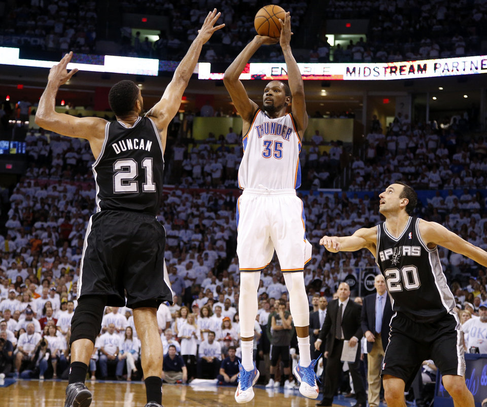 Photo - Oklahoma City's Kevin Durant (35) misses a 3-pointer from between San Antonio's Tim Duncan (21) and Manu Ginobili (20) late in overtime of Game 6 of the Western Conference Finals in the NBA playoffs between the Oklahoma City Thunder and the San Antonio Spurs at Chesapeake Energy Arena in Oklahoma City, Saturday, May 31, 2014. Oklahoma City lost 112-107. Photo by Bryan Terry, The Oklahoman