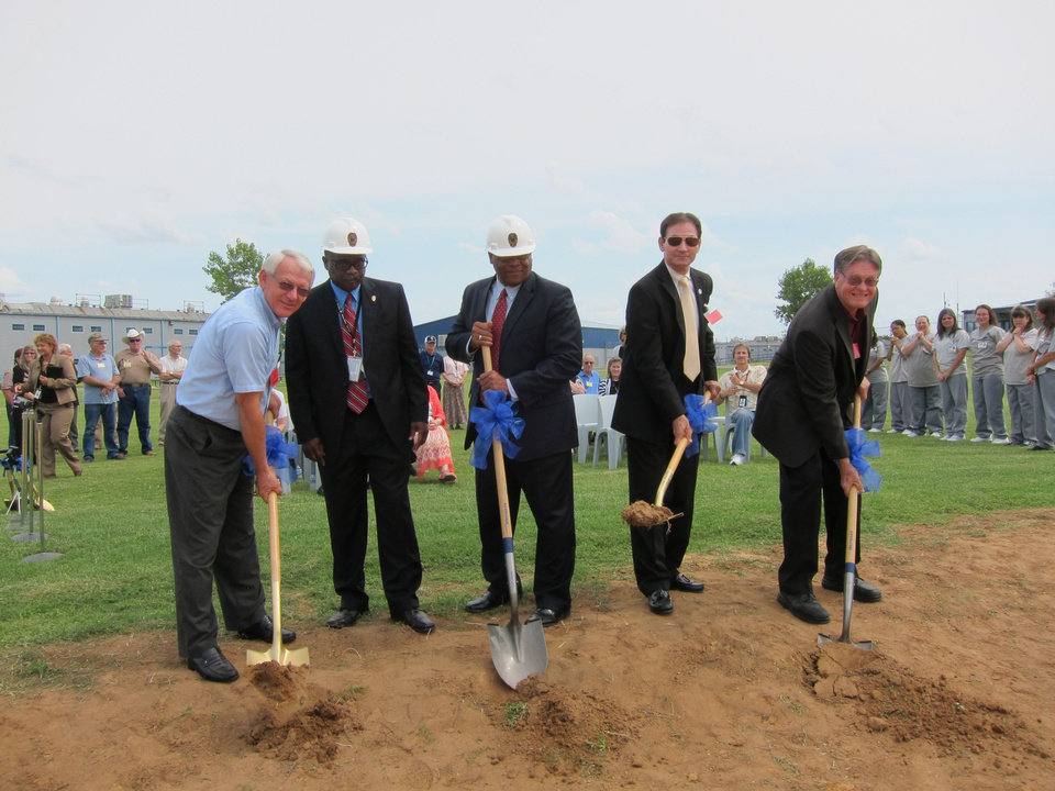 Photo - State leaders participate in a recent groundbreaking ceremony for a new chapel to be built in September at Mabel Bassett Correctional Center in McLoud. From left to right are: state Sen. Wayne Shaw, R-Grove; Rickey Moham, Mabel Bassett warden; Edward Evans, state Department of Corrections interim director; state Sen. Ron Sharp, R-Shawnee; and the Rev. Joe Wilson, domestic coordinator for faith-based World Mission Builders.