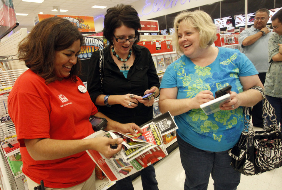 IMAGE DISTRIBUTED FOR TARGET - Target team member Melba Breidenstein assists Angela McCrary and Rebecca Freeman during Black Friday shopping on Thursday, November 22, 2012 in Hurst, Texas. (Richard W. Rodriguez/AP Images for Target)