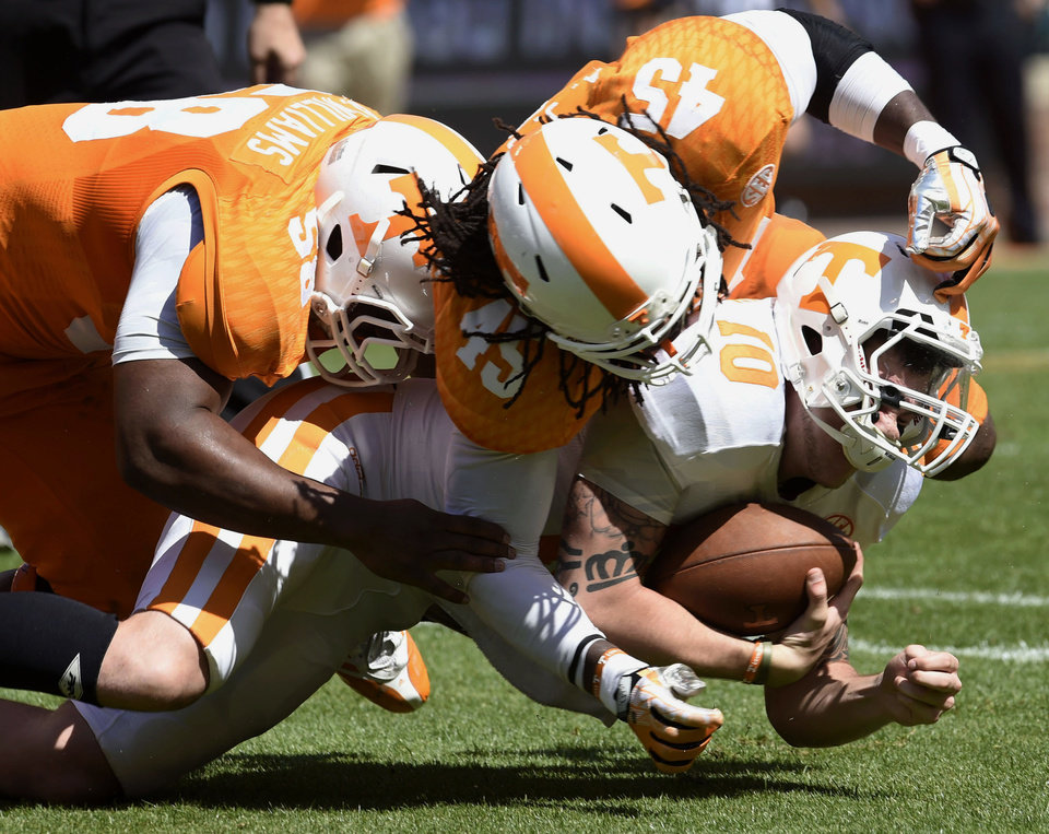 Photo - Tennessee quarterback Riley Ferguson (10) is stopped by linebackers A.J. Johnson (45) and Owen Williams (58) during the Orange and White game at Neyland Stadium in Knoxville, Tenn., Saturday, April 12, 2014. (AP Photo/Knoxville News Sentinel, Amy Smotherman Burgess)