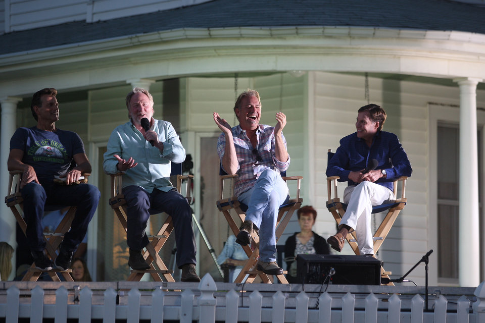 Photo - Bob Costas (right) hosts a question and answer segment with Field of Dreams cast members Dwier Brown (from left) Timothy Busfield, and Kevin Costner during the film's 25th Anniversary at the Field of Dreams movie site near Dyersville, Iowa, on Friday, June 13, 2014. (AP Photo/The Telegraph Herald, Nicki Kohl)