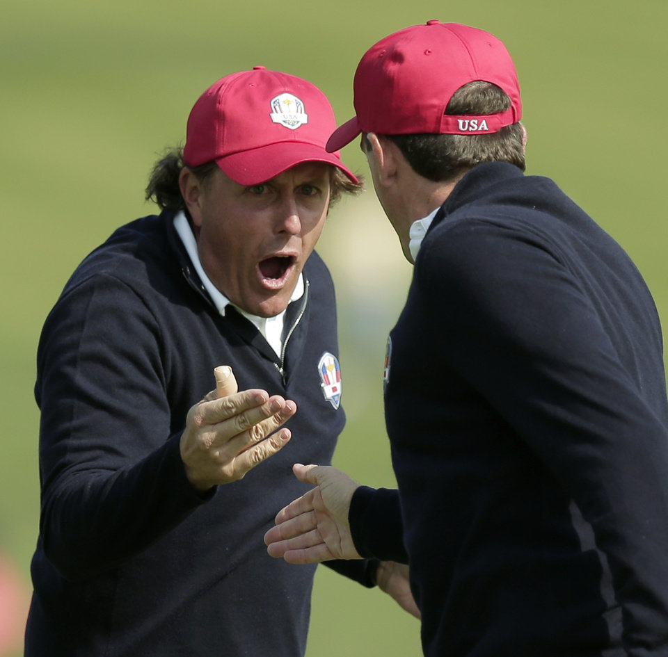 Photo -   USA's Phil Mickelson, left, and Keegan Bradley celebrate after winning their foursomes match on the 15th hole at the Ryder Cup PGA golf tournament Friday, Sept. 28, 2012, at the Medinah Country Club in Medinah, Ill. (AP Photo/Charlie Riedel)