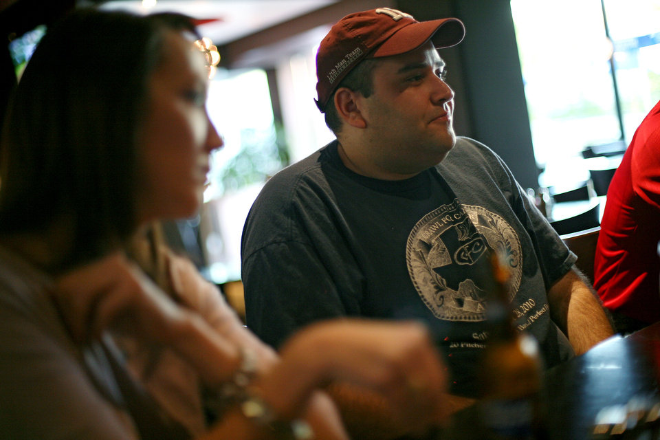 Robert Brauman (right) and Rhonda Goolsby (left) talk with other members of Texas A&M Club of Oklahoma City, during a meeting at RedPin Restaurant and Bowling Lounge in Oklahoma City on Wednesday, Aug. 24, 2011. Photo by John Clanton, The Oklahoman ORG XMIT: KOD