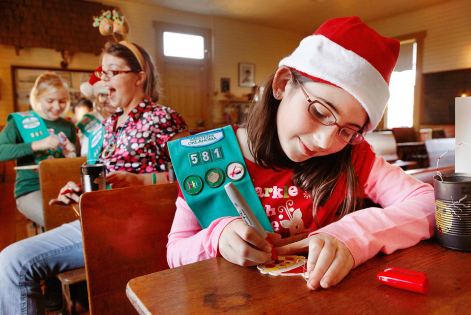 CHILD / CHILDREN / KIDS: Morgan Mitchell, 10, foreground, colors a tree ornament. Behind her is Genevieve Decker, 11. Both are members of Troop 581. Girl Scouts made Christmas ornaments at Edmond's 1889 Territorial Schoolhouse near  downtown Edmond Saturday, Dec. 17, 2011.  This activity was part of ongoing Downtown Edmond Christmas celebrations.  Photo by Jim Beckel, The Oklahoman