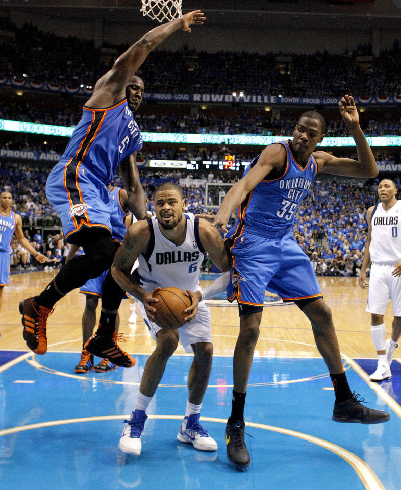 Oklahoma City's Kendrick Perkins (5) and Kevin Durant (35) defend Tyson Chandler (6) of Dallas during game 2 of the Western Conference Finals in the NBA basketball playoffs between the Dallas Mavericks and the Oklahoma City Thunder at American Airlines Center in Dallas, Thursday, May 19, 2011. Photo by Bryan Terry, The Oklahoman ORG XMIT: KOD