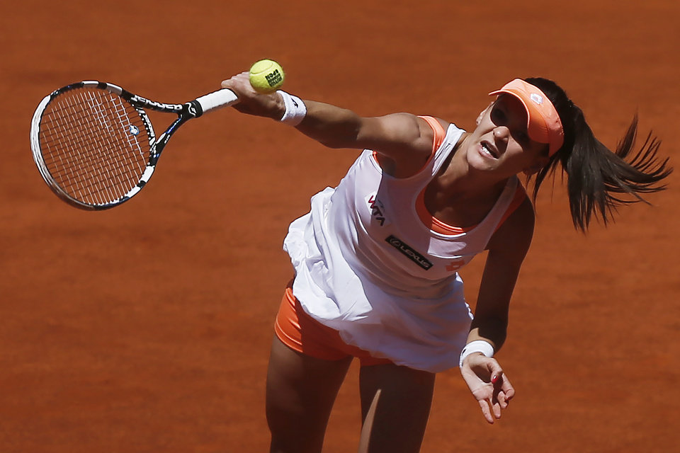 Photo - Agnieszka Radwanska from Poland serves during a Madrid Open tennis tournament match against Eugenie Bouchard from Canada, in Madrid, Spain, Monday, May 5, 2014. (AP Photo/Andres Kudacki)