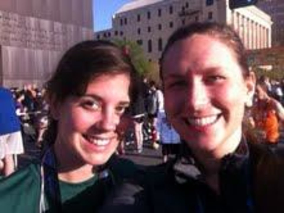 Oklahoman sports reporter Stephanie Kuzydym and Oklahoman copy editor Jordan Gamble in front of the National Memorial after they completed their  5K on Saturday.