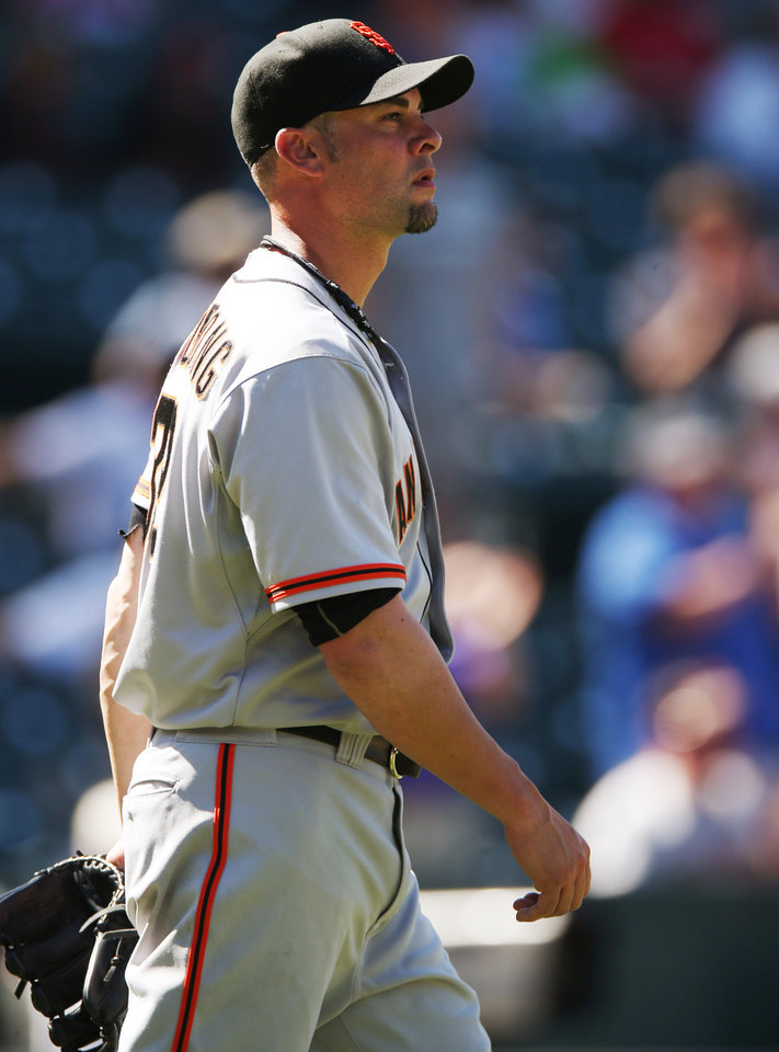 Photo - San Francisco Giants starting pitcher Ryan Vogelsong waits after giving up three-run home run to Colorado Rockies' Nolan Arenado in the fifth inning of the Rockies' 9-2 victory in a baseball game in Denver on Wednesday, Sept. 3, 2014. (AP Photo/David Zalubowski)