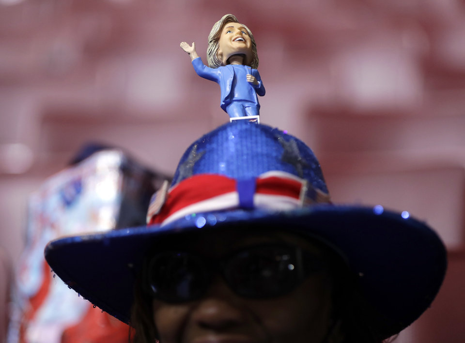 Photo - North Carolina delegate Rita Roberts shows off her hat as she arrives before the start of the first day of the Democratic National Convention in Philadelphia, Monday, July 25, 2016. (AP Photo/Matt Rourke)