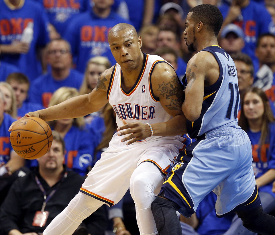 Photo - Oklahoma City's Caron Butler (2) works against Memphis' Mike Conley (11) during Game 7 in the first round of the NBA playoffs between the Oklahoma City Thunder and the Memphis Grizzlies at Chesapeake Energy Arena in Oklahoma City, Saturday, May 3, 2014. The Thunder won 120-109. Photo by Nate Billings, The Oklahoman