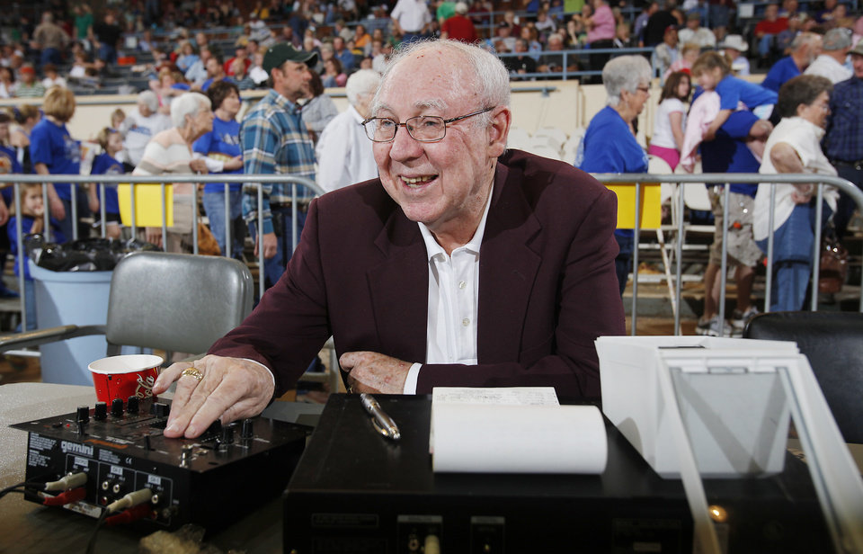Photo - Sound man Charlie Heatly works the music board during the semifinals of the Class B girls Oklahoma State Basketball Championships at the State Fair Arena on Friday, March 6, 2009, in Oklahoma City, Okla.  PHOTO BY CHRIS LANDSBERGER, THE OKLAHOMAN ARCHIVES