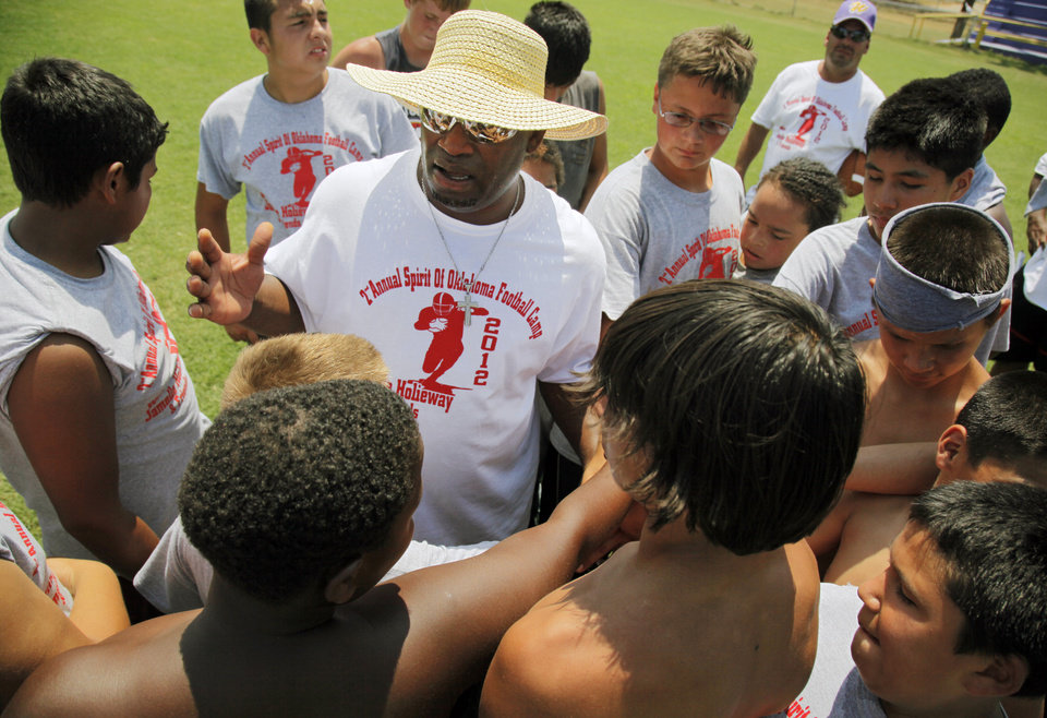 Photo - Former OU quarterback Jamelle Holieway gives a pep talk to a group of young football players during Holieway's Spirit of Oklahoma football camp in Weleetka, Okla., Friday, July 6, 2012. Photo by Nate Billings, The Oklahoman