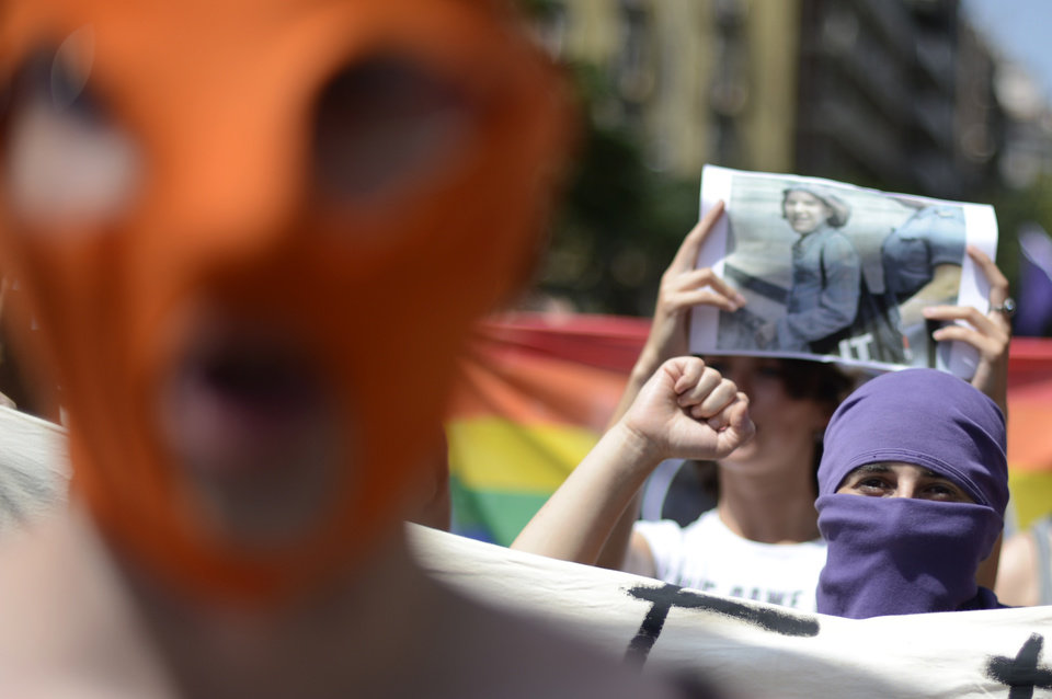 Photo -   Demonstrators shout slogans in support of the Russian punk group Pussy Riot during a protest in front of the Sagrada Familia church designed by architect Antoni Gaudi in Barcelona, Spain, Friday, Aug. 17, 2012. Three members of Pussy Riot were jailed in March and charged with hooliganism motivated by religious hatred after their punk performance against President Putin in Moscow's main cathedral. (AP Photo/Manu Fernandez)