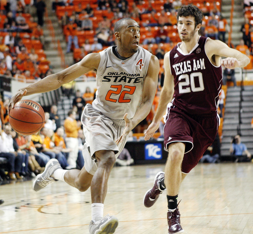 Photo - OSU's Markel Brown (22) drives to the basket as Texas A&M's Daniel Alexander defends during a men's college basketball game between the Oklahoma State University Cowboys and Texas A&M University Aggies at Gallagher-Iba Arena in Stillwater, Okla., Saturday, Feb. 25, 2012. OSU won, 60-42. Photo by Nate Billings, The Oklahoman