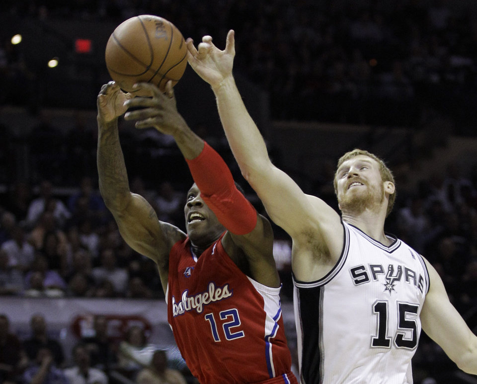 Photo -   Los Angeles Clippers' Eric Bledsoe (12) and San Antonio Spurs' Matt Bonner (15) reach for a rebound during the first quarter of Game 2 of an NBA basketball Western Conference semifinal playoff series on Thursday, May 17, 2012, in San Antonio. (AP Photo/Eric Gay)