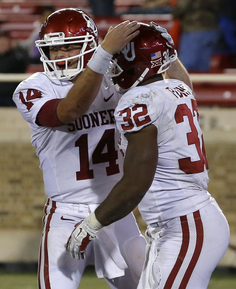 Photo - Oklahoma's Cody Thomas (14) and Samaje Perine (32) celebrate after Perine ran for a touchdown during a college football game between the University of Oklahoma Sooners (OU) and the Texas Tech Red Raiders at Jones AT&T Stadium in Lubbock, Texas, Saturday, November 15, 2014.  Photo by Bryan Terry, The Oklahoman