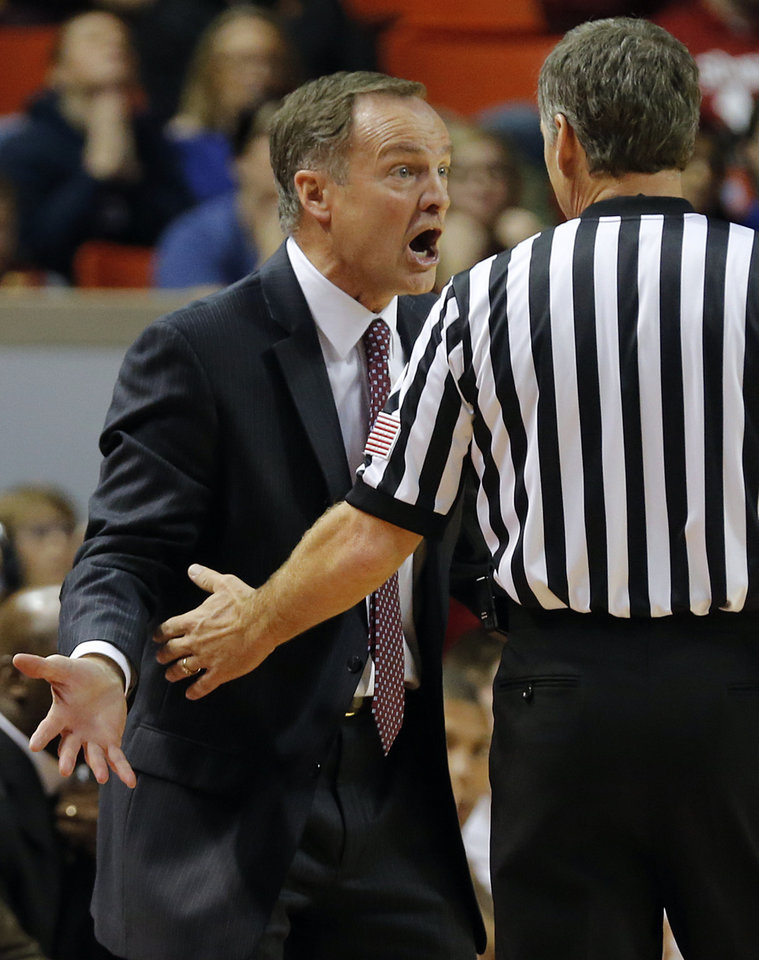 Photo - Oklahoma coach Lon Kruger yells at the official about a call during the NCAA college basketball game between the University of Oklahoma Sooners (OU) and the University of Kansas (KU) Jayhawks at Lloyd Nobel Center in Norman,  Okla. on Wednesday, Jan. 8, 2014.   .Photo by Chris Landsberger, The Oklahoman