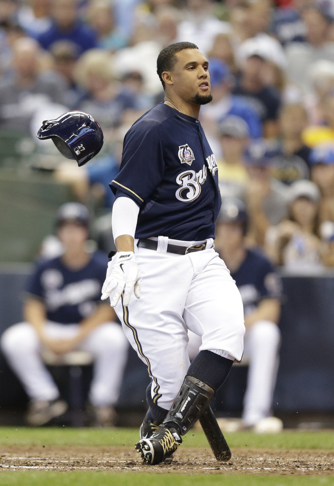 Photo - Milwaukee Brewers' Carlos Gomez strikes out against the New York Mets during the sixth inning of a baseball game Sunday, July 27, 2014, in Milwaukee.    (AP Photo/Jeffrey Phelps)