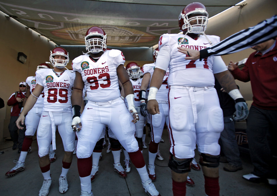 Officials keep the Sooners from going onto the field before the start of the Brut Sun Bowl college football game between the University of Oklahoma Sooners (OU) and the Stanford University Cardinal on Thursday, Dec. 31, 2009, in El Paso, Tex.   Photo by Chris Landsberger, The Oklahoman