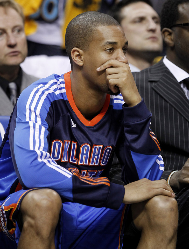 Photo - Oklahoma City Thunder guard Eric Maynor watches during the final moments of Game 6 against the Memphis Grizzlies in a second-round NBA basketball playoff series on Friday, May 13, 2011, in Memphis, Tenn. The Grizzlies won 95-83 to even the series 3-3. (AP Photo/Lance Murphey)