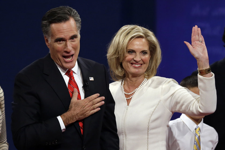 Photo -   Republican presidential nominee Mitt Romney and with wife Ann wave toward the audience after the first presidential debate at the University of Denver, Wednesday, Oct. 3, 2012, in Denver. (AP Photo/Charlie Neibergall)