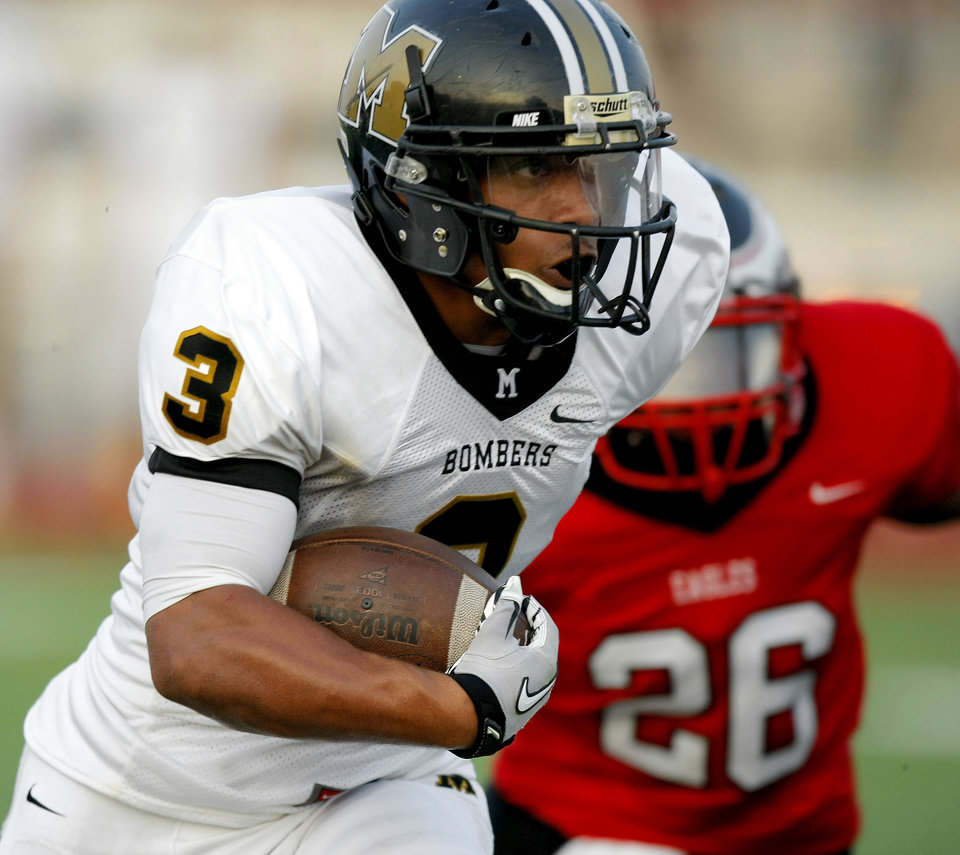 Midwest City's Zeke Lewis runs the ball against Del City during a high school football game in Del City, Okla., Friday, September 2, 2011. Photo by Bryan Terry, The Oklahoman