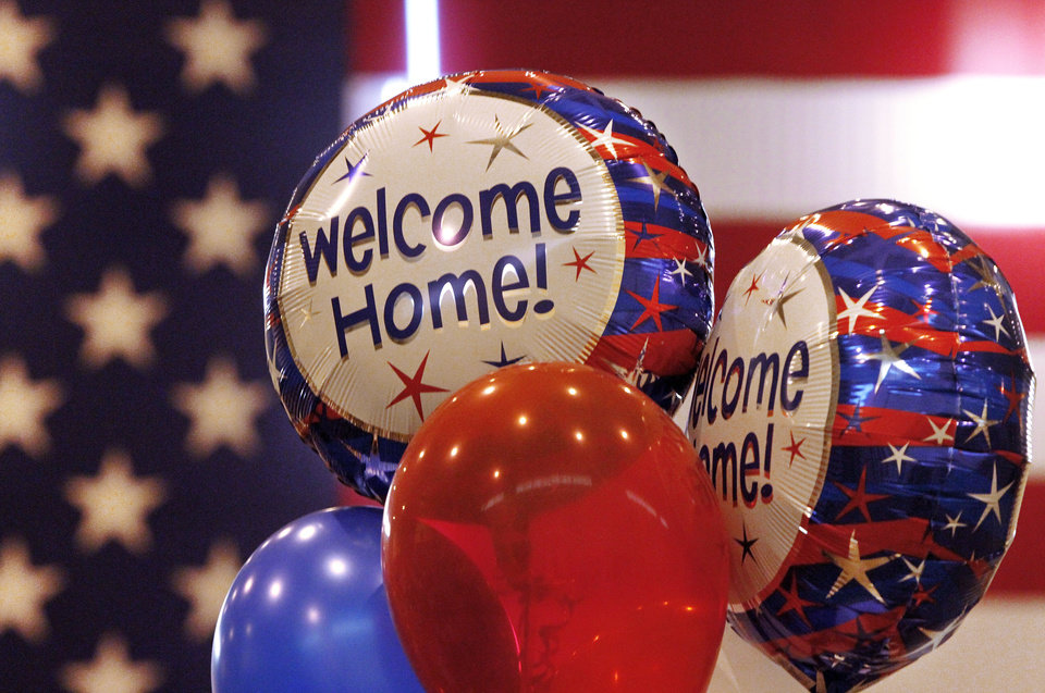 """Welcome Home"" balloons greet a contingent of returning soldiers in April. OKLAHOMAN ARCHIVES <strong>Jim Beckel</strong>"