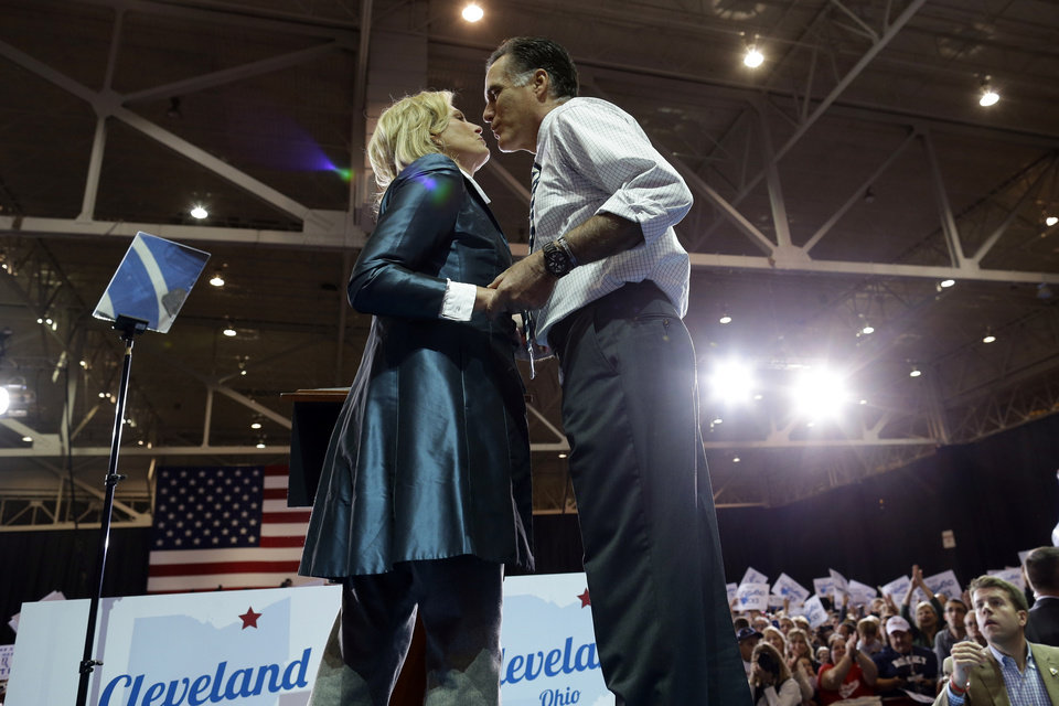 Photo -   Republican presidential candidate and former Massachusetts Gov. Mitt Romney leans over to kiss his wife Ann after she introduced him as they campaign at the International Exposition Center in Cleveland, Sunday, Nov. 4, 2012. (AP Photo/Charles Dharapak)