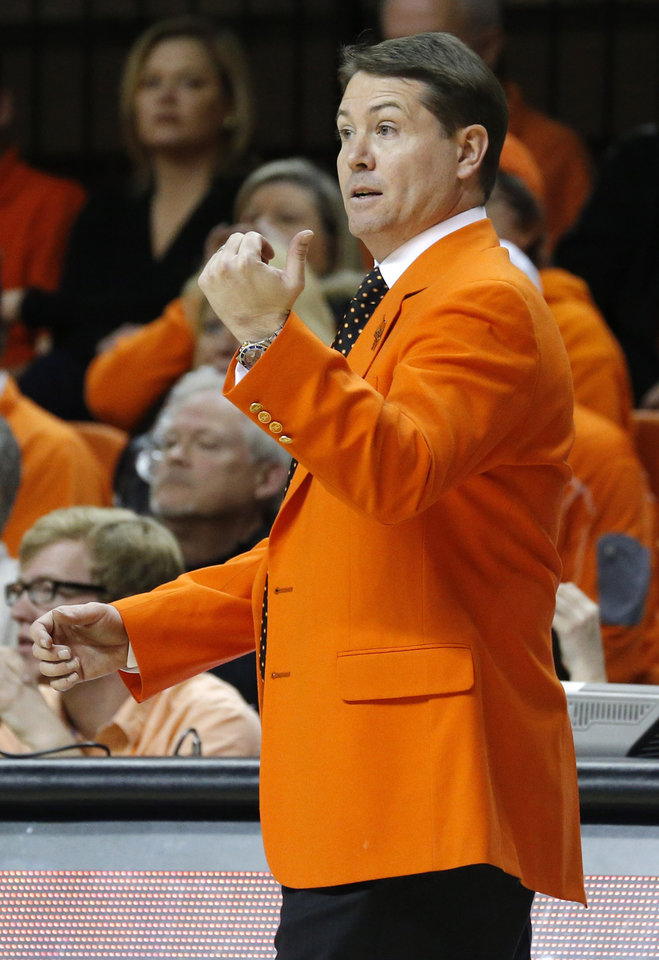 Photo - OU / OSU: OSU head coach Travis Ford coaches during the Bedlam men's college basketball game between the Oklahoma State University Cowboys and the University of Oklahoma Sooners at Gallagher-Iba Arena in Stillwater, Okla., Saturday, Feb. 16, 2013. Photo by Sarah Phipps, The Oklahoman