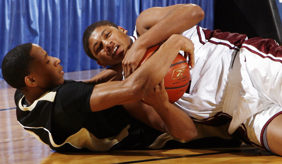 Photo - Okemah's Rashad Dunn (3), left, and Ramsey Butler (1) of Sequoyah-Tahlequah try to control a loose ball during the 3A boys semifinal game between Okemah and Sequoyah-Tahlequah in the Oklahoma High School Basketball Championships at State Fair Arena in Oklahoma City, Friday, March 13, 2009. Okemah won to advance to the finals. PHOTO BY NATE BILLINGS, THE OKLAHOMAN