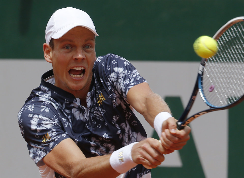 Photo - Tomas Berdych of the Czech Republic returns the ball to Kazakhstan's Aleksandr Nedovyesov during the second round match of  the French Open tennis tournament at the Roland Garros stadium, in Paris, France, Wednesday, May 28, 2014. (AP Photo/Michel Euler)
