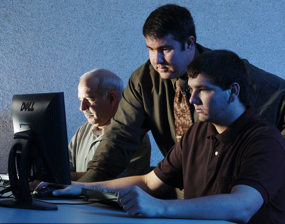 Professor Ken Dewey (pictured in the middle) works with Rose State College Cyber Security Students. Rose State College is the only two year college in the country to offer all six federal CNSS certificates in information assurance and cyber security Community Photo By: Steve Reeves Submitted By: Donna, Choctaw
