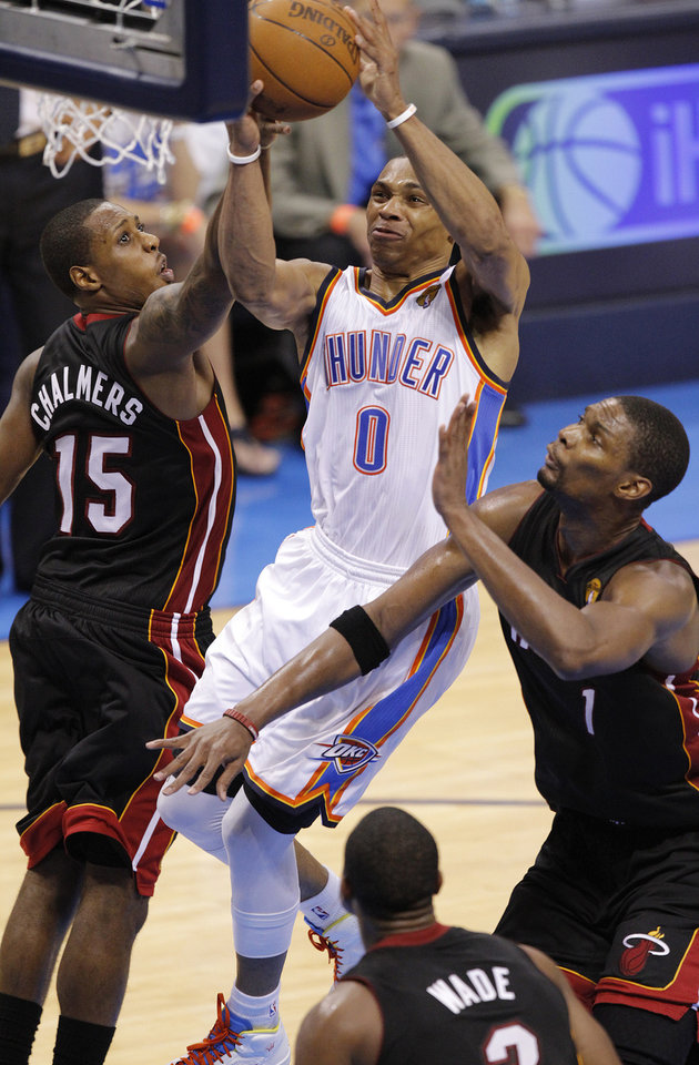 Oklahoma City's Russell Westbrook (0) shoots over Miami's Mario Chalmers (15) an Chris Bosh (1) during Game 2 of the NBA Finals between the Oklahoma City Thunder and the Miami Heat at Chesapeake Energy Arena in Oklahoma City, Thursday, June 14, 2012. Photo by Chris Landsberger, The Oklahoman