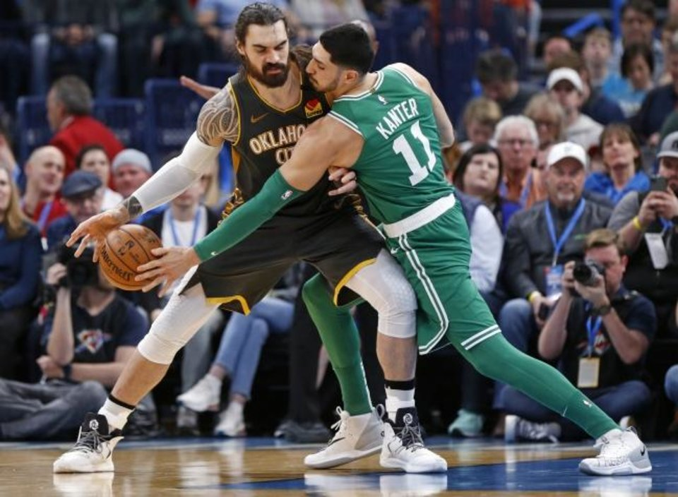 Photo -  Boston's Enes Kanter, right, knocks the ball away from Oklahoma City's Steven Adams during Sunday's game at Chesapeake Energy Arena. Kanter, a former Thunder player, remains a fan favorite in Oklahoma City. [Nate Billings/The Oklahoman]