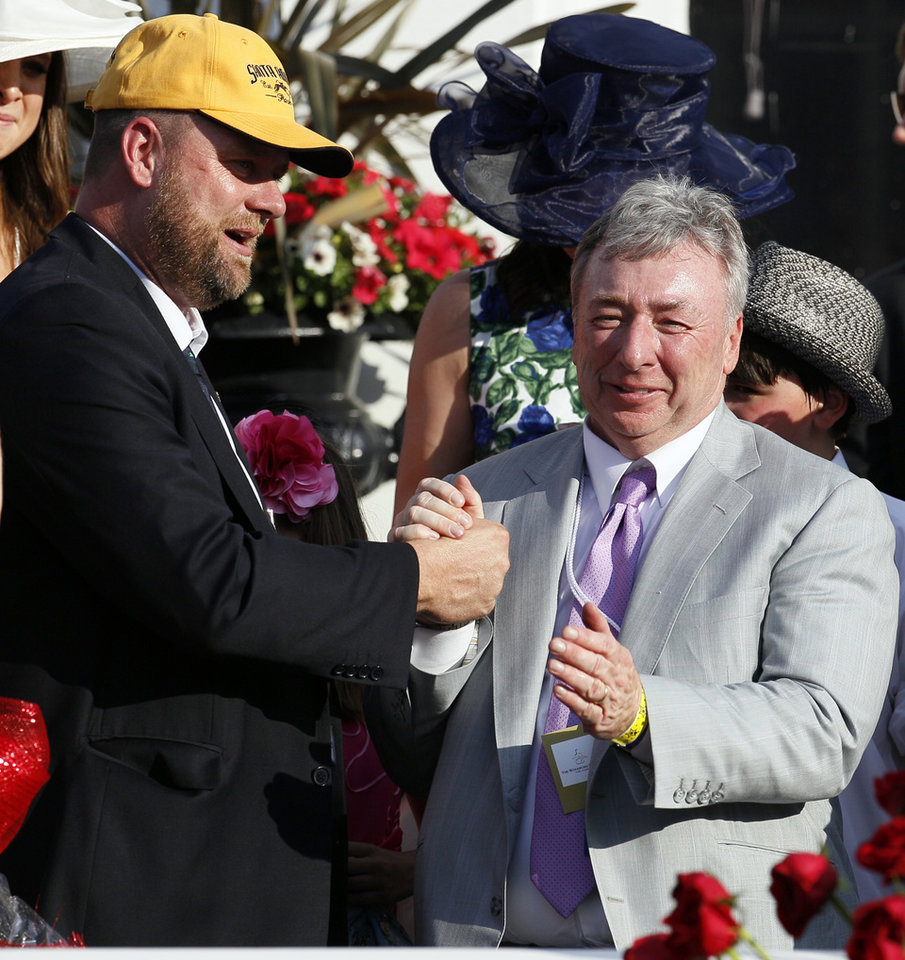 Photo - Trainer Doug O'Neill, left, reacts with owner J. Paul Reddam after I'll Have Another won the 138th Kentucky Derby horse race at Churchill Downs Saturday, May 5, 2012, in Louisville, Ky. (AP Photo/Mark Humphrey)  ORG XMIT: DBY205