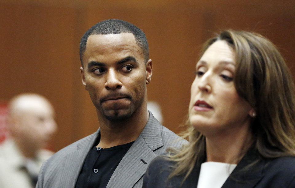 Photo - Former NFL safety Darren Sharper looks toward his attorney Blair Berk during an appearance in Los Angeles Superior Court in Los Angeles, where he pleaded not guilty Thursday, Feb. 20, 2014, to charges of drugging and raping two women. Sharper's bail has been increased from $200,000 to $1 million. (AP Photo/Mario Anzuoni, Pool)