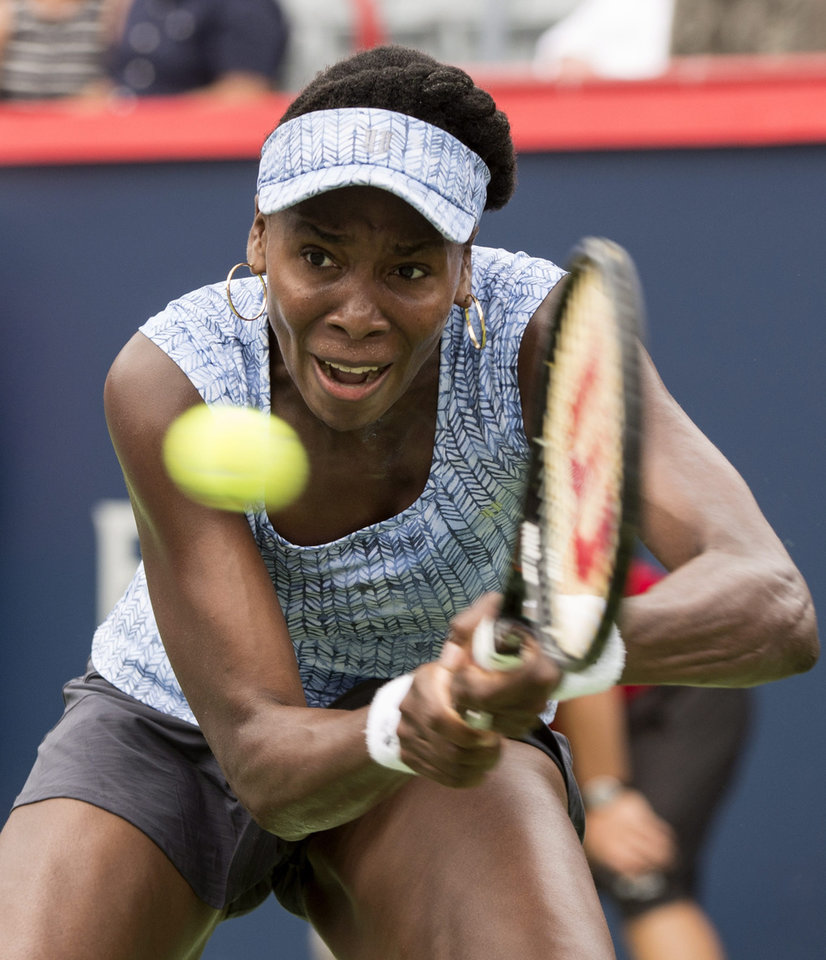 Photo - Venus Williams returns to Anastasia Pavlyuchenkova, of Russia,  during her first round match at the Rogers Cup tennis tournament in Montreal on Tuesday, Aug. 5, 2014. (AP Photo/The Canadian Press, Paul Chiasson)