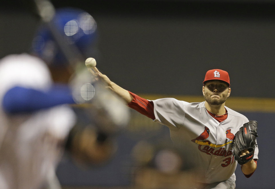 Photo - St. Louis Cardinals starting pitcher Lance Lynn throws to the Milwaukee Brewers during the first inning of  the MLB National League baseball game Monday, April 14, 2014, in Milwaukee. (AP Photo/Jeffrey Phelps)
