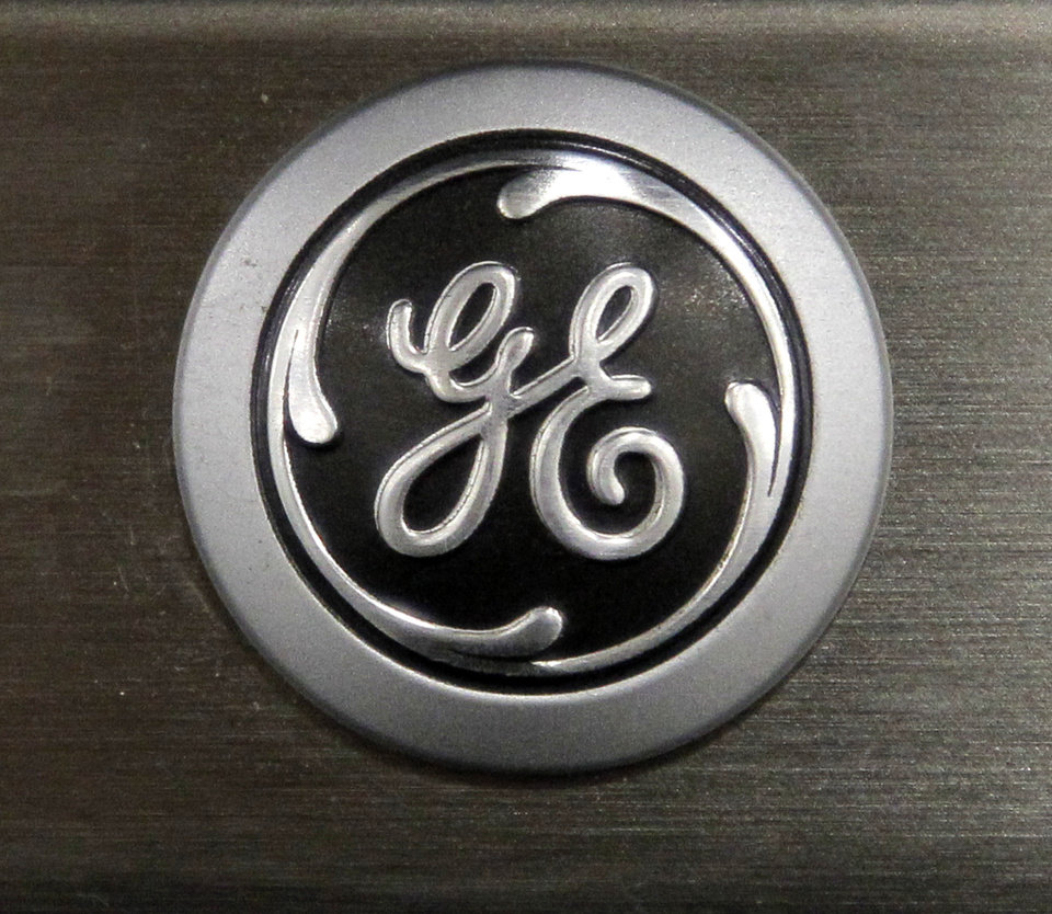 FILE - In this Monday, Sept. 10, 2012 file photo, a General Electric logo is seen on a kitchen stove at a Lowe's store in Framingham, Mass. General Electric Co. is reporting, Friday, Jan. 18, 2013, that net income rose 8 percent in the fourth quarter as earnings at all of the conglomerate's industrial segments improved due to growth in developing economies. (AP Photo/Steven Senne, File)